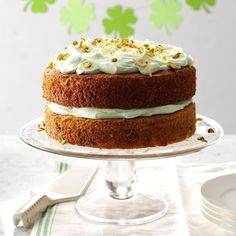 Pistachio & Coconut Cake Recipe -This coconut cake is good any time of the year, but the color is perfect for St. Patrick's Day. The secret is adding instant pistachio pudding mix into the cake mix and the frosting. —Dora May Meredith, Rockford, Illinois