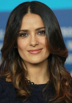 Salma Hayek Hairstyles: Sleek Medium Curls This center-parted hairstyle is more formal and it suited for any woman to get a nice everyday look! The brunette highlights on the ends make the overlook more stylish. Do you like it?