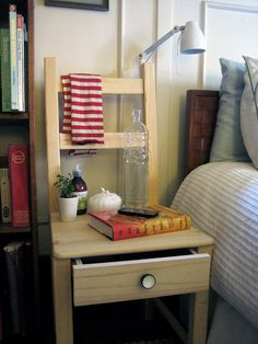 DIY Bedside Chair | Not just good for a bed-side, but great hidden storage in a small dining room! Cutlery in one chair, place-mats in another, and maybe coasters, napkin-rings or table-cloths in the others? Nothing too heavy or fragile, I would think. And maybe place the draws facing the other way so you don't have to pull the chairs out to access them.
