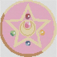 Celebrate your love of the Sailor Senshi with this recreation of Usagi's brooch. Kawaii Cross Stitch, Geek Cross Stitch, Cross Stitch Patterns, Stitching Patterns, Cross Stitching, Cross Stitch Embroidery, Embroidery Patterns, Cristal Sailor Moon, Perler Bead Art