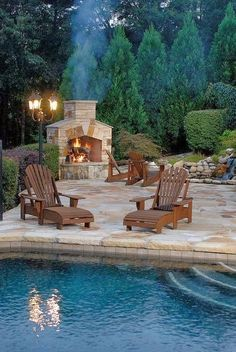 Chairs ♡ Backyard. Fireplace. Pool. Stone.