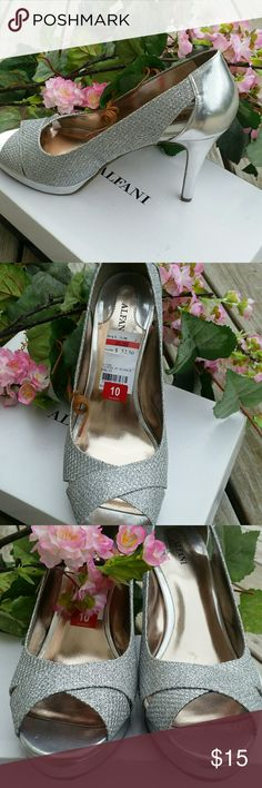 "Alfani silver peep toe shoes Used once. New condicion. Very comfortable. 3.5"" heel and .5"" in platform. Alfani Shoes Heels"