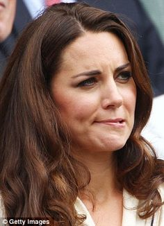 Tense: Kate bites her llip as she watches the Murray match