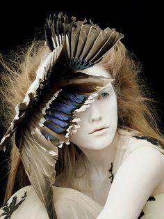 Vlada Roslyakova wears feathered headdress by Philip Treacy forAlexander McQueen F/W 2006 photographedby Ben Hassett forVogue Nippon Beauty September 2006