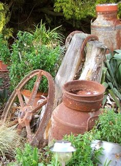 Old wheels and milk churns...reminds me of Nans farm! Must find some!