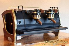 Model A This custom espresso machine was featured at SCAA 2014, where we were hosted by Colectivo Coffee. Platform: 2 group La Marzocco Strada EE. Features: Brass side panels, with walnut inlay, walnut paddles and portafilter handles. Contact Pantechnicon Design to discuss custom machine options.