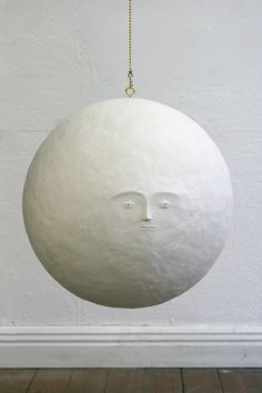 moon-could be a moon hanging lamp made with string?  Tissue /Paper glue over a large balloon with a commercial bulb & cord sold for same purpose.