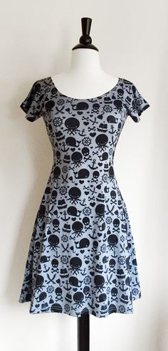 PLEASE READ: There is a 2-3 week turnaround time for these dresses so if youd like yours by a particular time please keep that in mind. Now for the fun stuff:  ARGHHH! Its adventure time pirate style in this adorable dress! There are skulls, sea creatures, hooks, ships, swords and more! The silhouette of this dress is incredibly flattering with a fitted top and then a lovely flared out bottom. 90% Polyester and 10% Spandex for a comfortable stretch.  I find these dresses fit true to size but…
