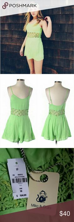 NWT LF S Lime Green Crochet Cutout Romper Brand new w/ tags. Lime green romper with cute crochet cutout detail around the waist. Scoopneck. Adjustable straps. Side pockets. Concealed side zipper. 50% Cotton/ 50% Polyester. Retailed at LF for $154. By Mika & Gala. I have sz 8 & 10 (Aus), which = 4 & 6 US respectively. Sizing has been converted in buying options.  Please check out my closet for more NWT LF items to bundle w/ discount & save more w/ 1 shipping fee. LF Pants Jumpsuits & Rompers