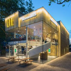 """This McDonald's with a perforated golden facade and a spiral staircase was designed by Mei Architects to replace """"the ugliest building in Rotterdam"""""""