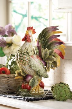 The Vista Bella Rooster Figurine is a colorful way to add Rooster Decor to your home or table. A vibrant blend of bountiful vegetables and retro graphics invigorates traditional Italian inspired design in Vista Bella from Fitz and Floyd. Featuring rich colors found in the freshest produce.