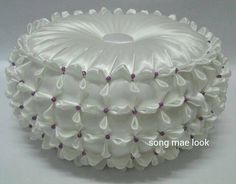 I haven't seen a circular pillow with this smocking on the sides before.