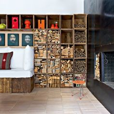 A loft in Florence where architect, Alessandro Capellaro used vintage found boxes to create this modular bookcase which is filled with different sizes of reclaimed wood Image from Marie Claire Maison, photo by Nicolas Mathéus . - My-House-My-Home Style At Home, Diy Interior, Interior Design, Interior Architecture, Firewood Storage, Firewood Rack, Wood Fireplace, Fireplaces, Modular Furniture
