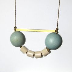 Summer necklace  Wooden beads in a brass chain and a by sewasong, $36.00
