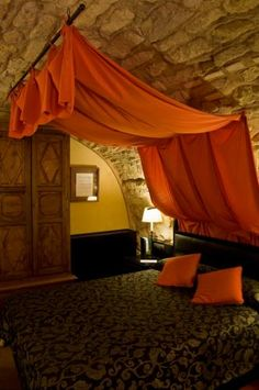 Castle Bohemian bed curtains - this room gives me that childhood adverturous feeling back!!! Let's go treature hunting now! ;)