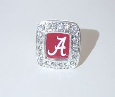 Support Your Alabama Crimson Tide with this elegant, beautiful, and stylish square logo stretch ring surrounded by clear crystals. Shout to everyone where your pride lies without even saying a word wherever you go. They feature a NCAA Officially Licensed logo, clear crystals, silver plated, and fits up to size 5. Complete the Collection, be sure to check out the matching Earrings,