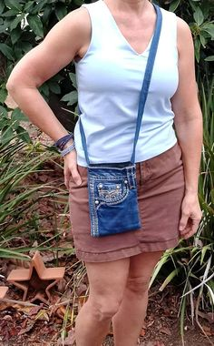 This denim crossbody bag/purse is handmade using upcycled, recycled, and repurposed denim blue jeans, Rock Rivival brand jeans. This denim bag is fully lined with a black and gray stars pattern cotton material. There are two pockets on the outside, front of the denim bag, which are perfect