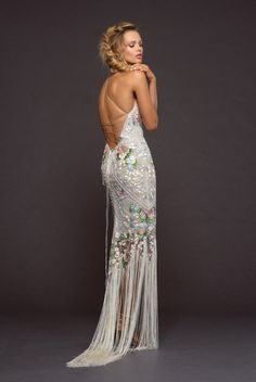 5bb6071b96 Style Iggy Joli Jardin embroidered fit to flare gown with fringe hem.  Hayley Paige