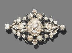 A 19th century diamond brooch  The openwork navette-shaped plaque of floral and foliate motifs, set throughout with rose-cut diamonds, all within closed-back collet settings, mounted in silver and gold, width 5.6cm.