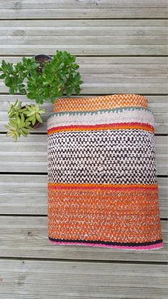 Bohemian and colourful vintage Peruvian Blanket.  Material: It has been hand-woven from hand-spun alpaca and sheep wool using a traditional back strap loom. All dyes are organic from natural plant sources. Two pieces of cloth are made to the width of the loom and then sewn together. It takes around six weeks to make. They are thick and each is one-of-a-kind in colour and design.  Frazadas can be used as rugs, throws, table cloth, bed coverings, picnic blankets, or wall hangings. The…