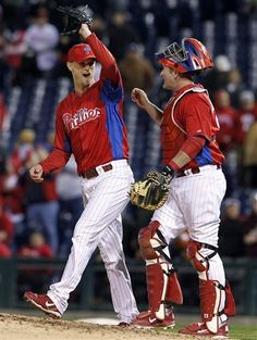Philadelphia Phillies relief pitcher Kyle Kendrick, left, reacts with catcher Brian Schneider after an exhibition baseball game against the Pittsburgh Pirates on Monday, April 2, 2012, in Philadelphia. The Phillies won 4-3.