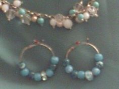 hand made  earrings  and  bracelet..blue/ pink/ gold beads...