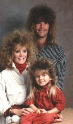 80's hair!!! I have no doubt they're already regretting this picture.