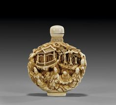 Very elaborately carved in deep relief, ivory snuff bottle; with typical continuous design of figures and buildings in landscape, two character mark, polished ivory stopper; H: 2 1/2""