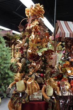 Harvest the Holidays! Tree decorated by Craig Bachman Imports.....stunning! Many items used on this tree will be arriving to www.trendytree.com this summer!