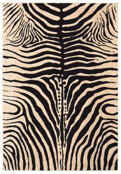 Animal prints have the power to be classic and exotic all at once. Full of timeless allure and intrigue, our Waitsfield in Zebra is of no exception. Smooth gray details, intertwined between black and white highlights of color, give this rug a distinct texture and a beauty that is all its own.