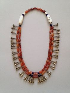 """Naga (Nagaland), Ao people. Necklace made of carnelian, glass, shell and brass. Often this type is referred to as a """"trumpet"""" necklace. Posted by Angelo Filomeno, who is in the process of collecting fine pieces, on Sarah Corbett's website """"ethnic jewels"""".  ethnic jewellery and adornment Facebook page"""