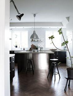 Kitchen, black cabinets, stainless steel, concrete countertop, white subway tiles, herringbone floor, scandinavian