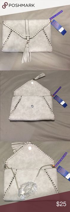 "NWT Whipstitch clutch Faux leather cross body or clutch. Fold over flap with snap closure and removable chain link shoulder strap with 23"" drop. Dimensions 11 1/4"" x 1  1/2"" x 7 1/2"". Available in Grey and Cognac Bags Clutches & Wristlets"