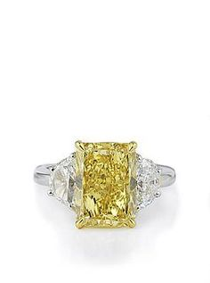 """""""Fancy Yellow"""" Radiant diamond flanked by two white diamond half circles.  By Bez Ambar.  Available at Alson Jewelers."""