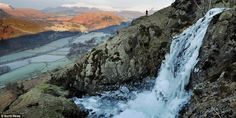 Ice, ice baby: Frozen in full flow, this dramatic waterfall at Fisher Gill in the Lake District appears still to be frothing and bubbling, as fell walker Martin Campbell looks on in wonder