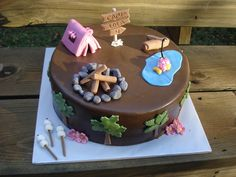 This cake goes with the camping cupcakes.  Cake is chocolate chip pound cake with chocolate ganache filling.