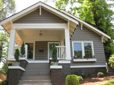 Renovated Bungalow - atlanta Valspar...foggy mist and hush hush.  Brick painted same color??
