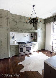 Ashley Gilbreath Interiors   Old Cloverdale House   Montgomery Alabama   Cypress Kitchen Cabinets   Cowhide Rug   Marble Backsplash