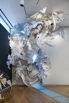 Mia Pearlman- site-specific cut paper installations.