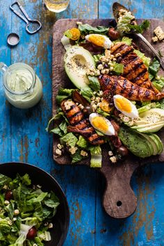 overhead photo of BBQ Chicken Cobb Salad with Avocado Ranch with salad on cutting board