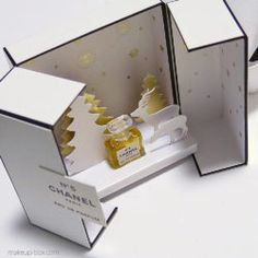 A special gift under the Christmas tree. Once it has been opened, this plain gift box from Chanel transforms itself into a magical snowy landscape. Photos: makeup-box.com