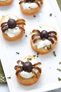 "Whipped Goat Cheese Crostini with Olives – ""Spider Bites"" - Crostini with whipped goat cheese and olives is a fun, easy and impressive little snack that your entire family will love! With California Ripe Olives, these little spider bites are sure to impress!  #CalOliveCrafts #CleverGirls @CalRipeOlives"