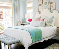 A quilt purchased in India, which drapes the end of the bed, inspires the soothing color palette of this bedroom. A watery shade of blue colors the walls and drapes and the pillows, and the monochromatic approach keep the loo