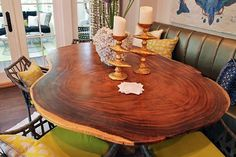 Angela Elliott of Angela Elliott Interiors designed the home's kitchen and breakfast area. It features a $4,500 table with a root base. Read detailed article at http://www.richmondbizsense.com/2014/09/11/symphony-orchestrates-mansion-makeover/  Photo by Brandy Brubaker