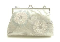 Beaded Flower Bridal Bag - This very pretty wedding bag has boho beaded flower detailing made up of mother of pearl coloured sequins with light pastel and clear coloured seed beads. It has a short satin ivory wrist strap (not hideable). Silver frame and kiss clasp. Very pretty! Approx: 24cm x 15cm, depth across base 7cm.