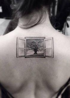 Fine line style window tattoo on the upper back. Tattoo artist: Dr. Woo