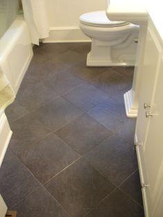 Black slate tiles Bathroom makeover; Tile set in diamond pattern to visually expland room/flloor; good for long narrow floors