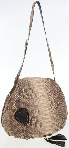 This Gucci Python Messenger bag features an adjustable shoulder strap allowing for a hands-free carrying option.
