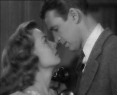 """jimmy stewart as george bailey trying not to kiss donna reed as mary hatch in """"it's a wonderful life."""" i adore this scene, and this is my favorite movie of all time ever. <3"""