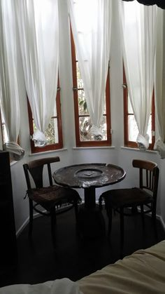 Morrocan style white curtains, tied in knots. Korakia Pensione, Palm Springs, Artist Studio